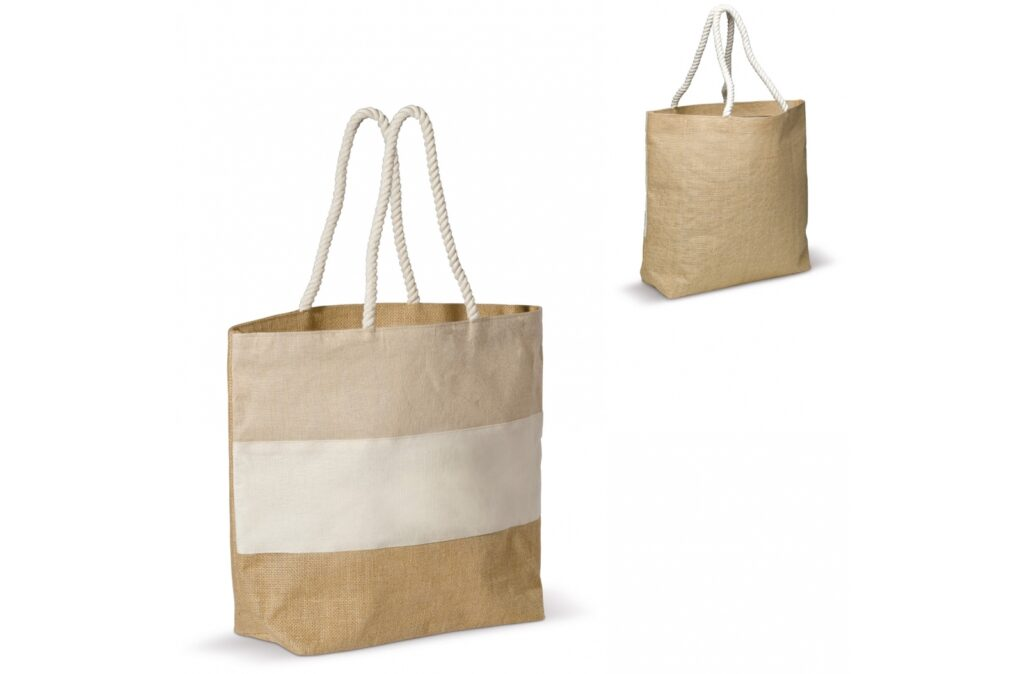 Large beach bag made of jute and canvas. The thick ropes used as shoulder strap add to the natural characeristics. With laminated backing, the bag can also be used to carry groceries.