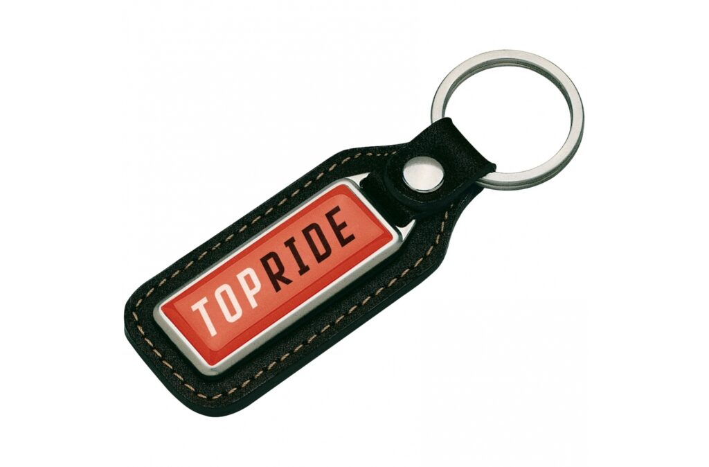 A metal rectangular keyring made from real leather with a single sided doming.